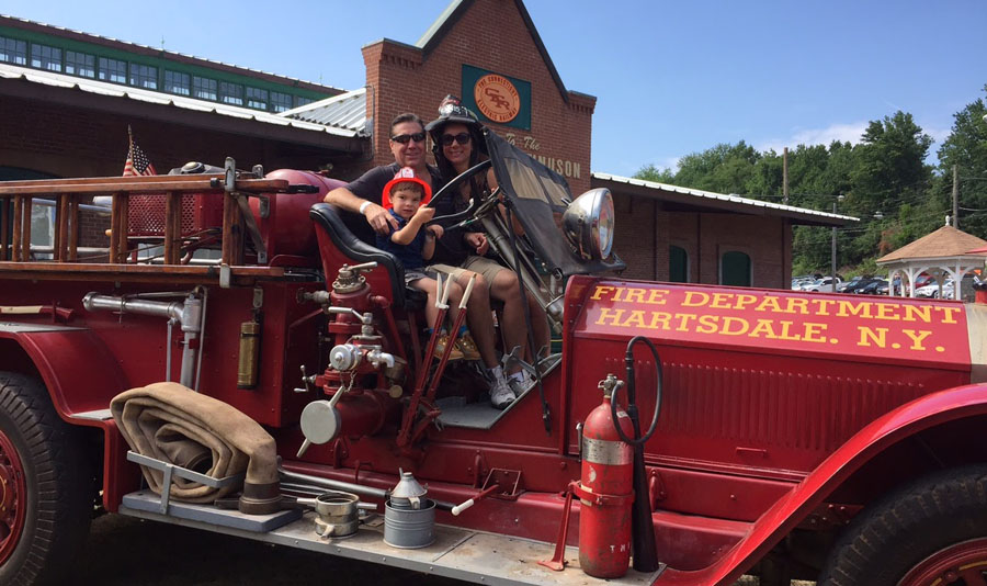 Sit atop an antique fire truck